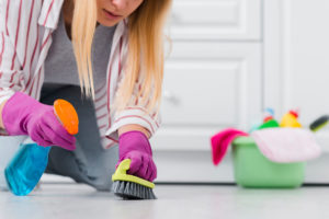 close-up-woman-spray-cleaning-floor (1)